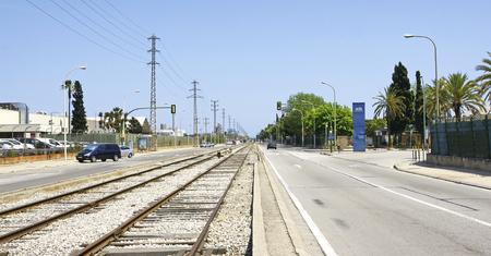 railroad tracks: Railroad tracks on a road in the Zona Franca de Barcelona