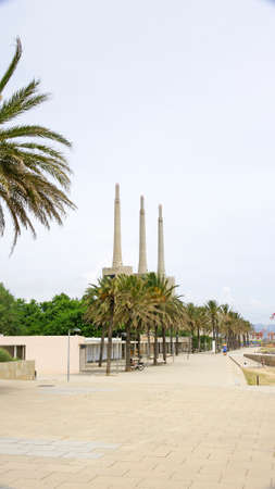 fireplaces: Beach in Sant Adria de Besos With three fireplaces at background, Barcelona Stock Photo