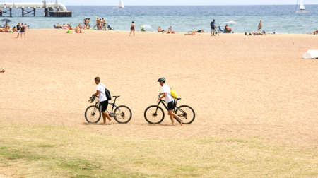 adria: Two bikers on the beach of Sant Adria del Besos, Barcelona