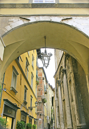 Arch and street of Lucca, Tuscany, Italy Stock Photo