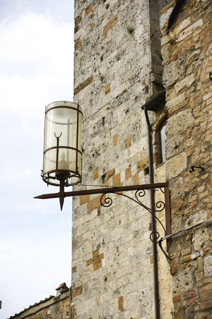 Detail of street lighting in San Gimignano, Tuscany, Italy