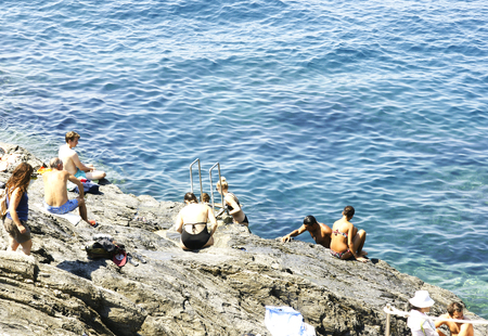 Vacationers and tourists in Manarola, Cinque Terre, Italy