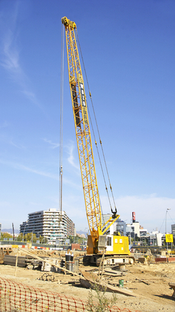 Yellow crane in the works of Les Glories of Barcelona Stock Photo