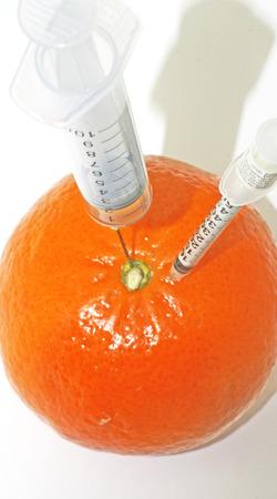 Syringe injected into an orange
