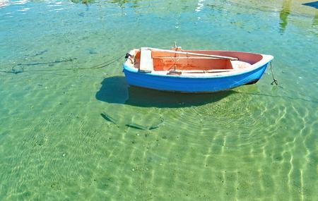 Lonely boat on a beach in Mykonos, Greece, Europe