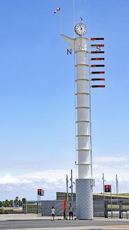 Pole with wind rose indicator in the Parc Forum of Barcelona, Catalunya, Spain