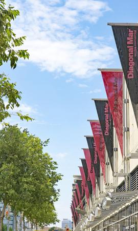 Banners on a facade of a shopping center, Barcelona, Catalunya, Spain