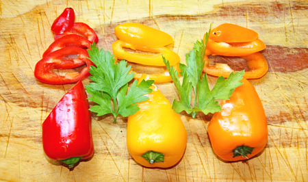 Colorful peppers on cutting board Stock Photo