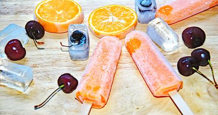 Orange and lemon ice cream Фото со стока