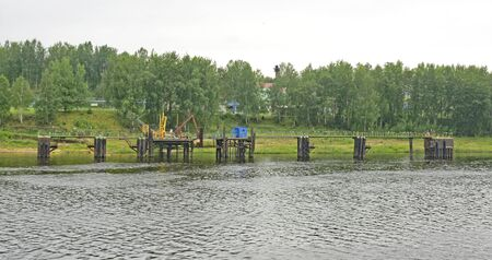 Factories, buildings and works on a river bank in Russia, Russian Federation