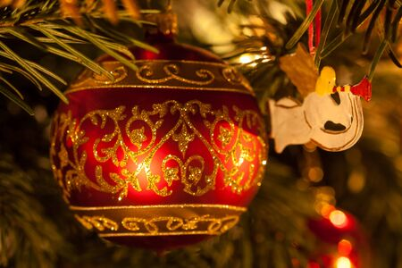 fragility: Closeup of a red Christmas tree ball