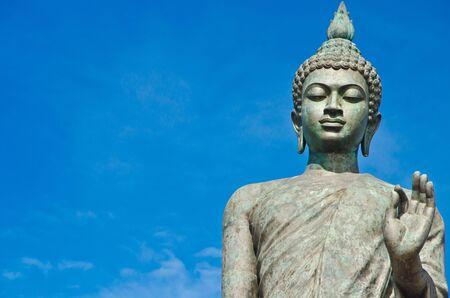 buddha image: Big Buddha image with blue sky at Phutthamonthon, Nakhon Pathom, Thailand