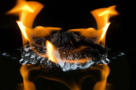 Fire in outdoors Stock Photo