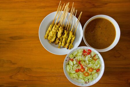 Pig satay  with peanut sauce and vinegar in thailand photo