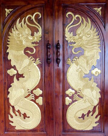 Dragon door  is made out of teak in Thailand