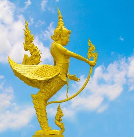 Kinnari statue sky background in Thailand
