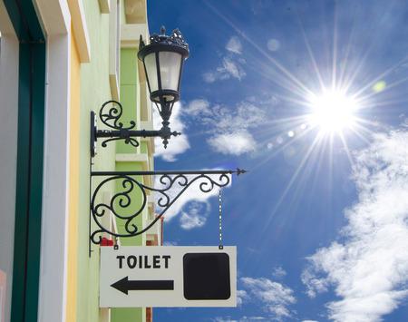 Toilet sign blue background