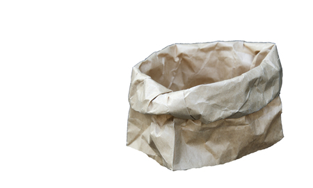 Brown paper bag on a  White background. Stock Photo
