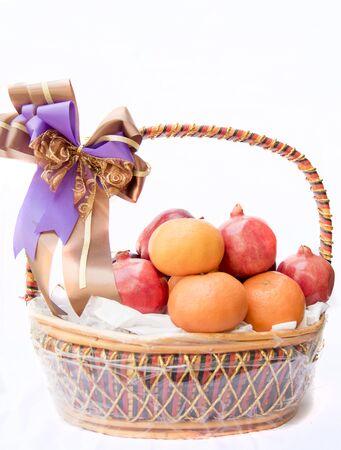 The fruit basket, isolated on white background Stok Fotoğraf - 132063456