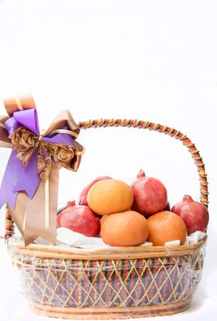 The fruit basket, isolated on white background Stok Fotoğraf - 132062941