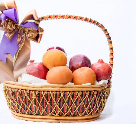 The fruit basket, isolated on white background Stok Fotoğraf - 132063448
