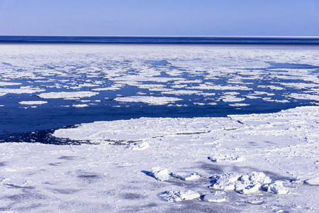 Landscape with drift ice in the Okhotsk Sea Stock Photo