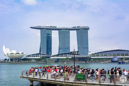 Marina Bay Sands Hotel with Tourists in Merlion Park