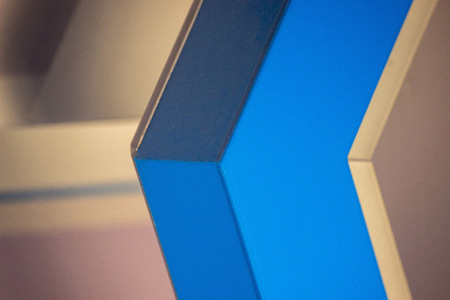The white blue geometric background. a lot of angles lines and a few shades of color, arrow direction, the desire