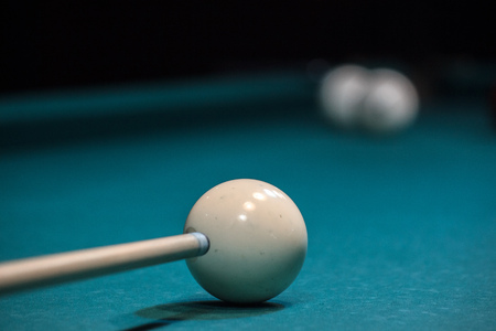 the cue is aimed at white ball, accurate blow to the ball. to score in a pocket, to win.