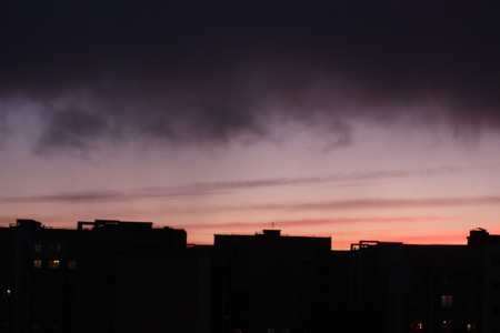 dawn against the dark sky with clouds, colorful sky from the rising sun
