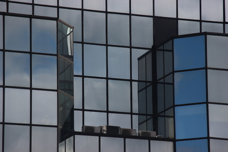 Windows of modern house. glass skyscraper in the city, fashionable office building with floor-to-ceiling Windows. bright rooms and modern construction. new opportunities for incarnation in reality.