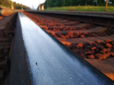 railway at sunset. vehicle, urban transport. rails and sleepers in last sunlight. travel around the country during holidays and weekends Reklamní fotografie