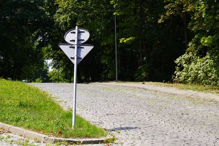 a bent road sign, bent post. traffic regulations. road safety