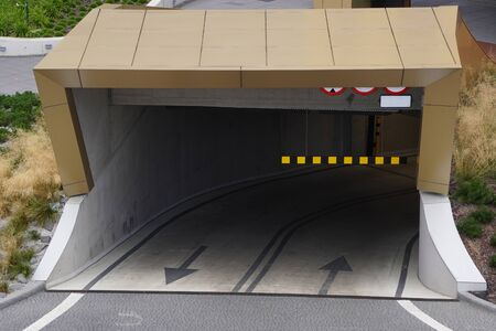 open entrance to underground Parking, modern Parking under the building, saving space in the city. car protection, safety 스톡 콘텐츠