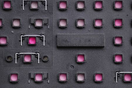 the black perforated plastic with pink substrate, symmetrical volumetric pattern