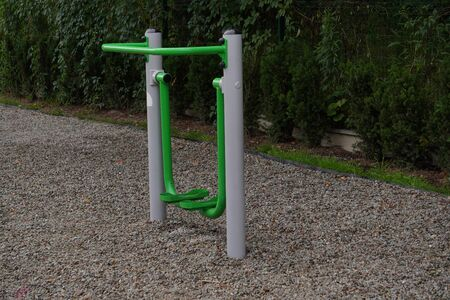 outdoor green-gray iron exercise machine for sports. public gym, muscle building, exercise