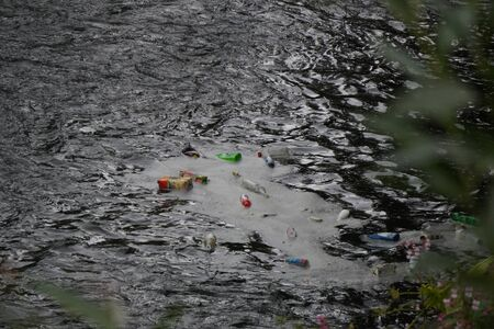 Poland, Zakopane 07.08.2019: garbage floats in the river, pollution. zero waste, vegan, take care about the planet. take trash with yourself. trash sorting 版權商用圖片