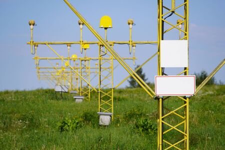 yellow metal support systems of care during takeoff and landing - landing direction light near runway. air traffic safety.