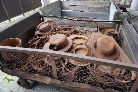 rusty iron residues from the production of stamping are in the cart. damage metal over time