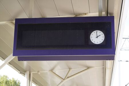 scoreboard at station with a clock for the schedule, track and platform, as well as the departure time. waiting for the arrival or departure of trains, trains Stok Fotoğraf