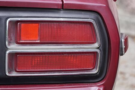 rear red headlights of old Soviet car. brake lights and turn signal. details of the auto.