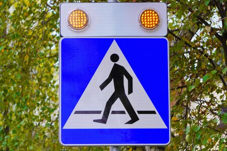 signal transmission, modern tracking systems, security and safety on the roads. signal for the driver about the presence of a pedestrian at the crossing. orange lights 스톡 콘텐츠