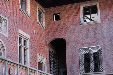 old red brick building, decorated Windows and doors, balcony to courtyard,