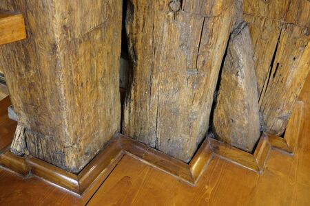 massive wooden supports in the structure of the old building. old wood, impregnated with varnish. support the building