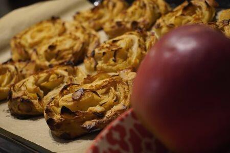 One fresh cinnamon bun with the apples and almond flakes. Home baking, healthy eating, cooking at home. Ready to Eat. Harvest apples. Recipes with apples.