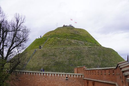 the high mound at the red stone fence. the burial mound, View of Kosciuszko Mound, located in Krakow, Poland.