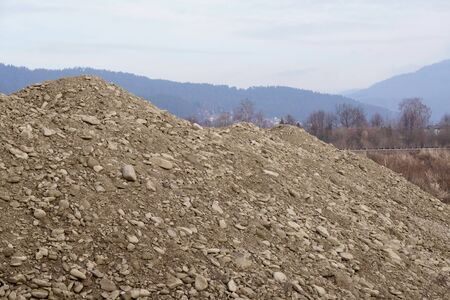 Hill sand and stones on background of mountains in the Zywiec area. Extraction or mining stones.