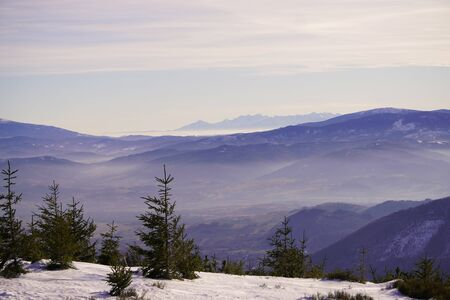 Panoramic view of winter and snowy landscape from the observation platform at the peak of mountain in Szczyrk, Skrzyczne localization Beskid Mountains. Screensaver, copyspace or natural background.