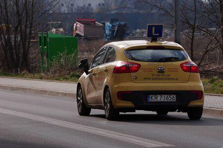 Krakow, Poland 02.15.2020: Training L-signed car's roof on street. Driving license school. Redakční