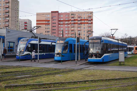 City blue trams at the final stop. Infrastructure for urban public transport. Platforms for trams. Eco-friendly urban public transport. protection of environment